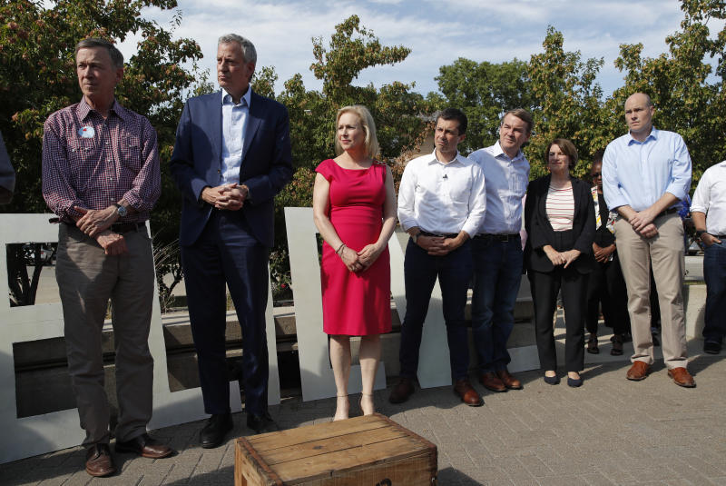 From left, Democratic president candidate and former Colorado Gov. John Hickenlooper, New York Mayor Bill de Blasio, Sen. Kirsten Gillibrand, D-N.Y., South Bend Mayor Pete Buttigieg, Sen. Michael Bennet, D-Colo., and Sen. Amy Klobuchar, D-Minn., stand together before the Iowa Democratic Wing Ding at the Surf Ballroom, Friday, Aug. 9, 2019, in Clear Lake, Iowa. (AP Photo/John Locher)