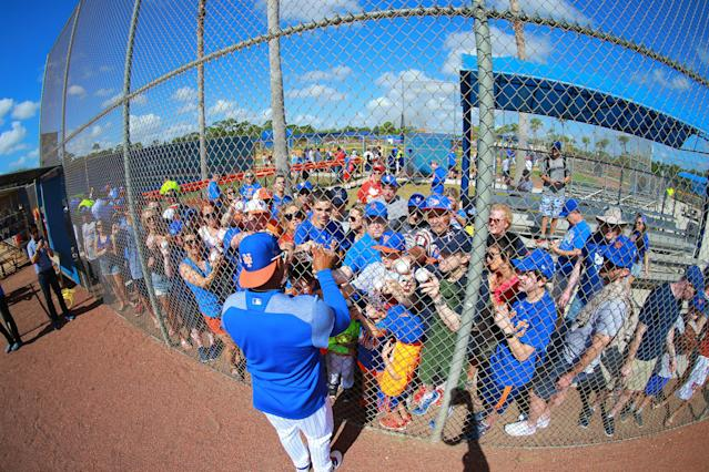 <p>New York Mets outfielder Yoenis Cespedes signs for fans after workouts at spring training in Port St. Lucie, Fla., Feb. 23, 2018. (Gordon Donovan/Yahoo News) </p>