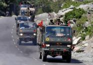 FILE PHOTO: Indian Army convoy moves along a highway leading to Ladakh, at Gagangeer