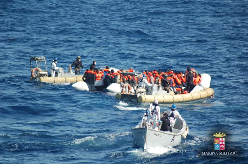 Picture released by the Italian Navy (Marina Militare) shows a rescue operation of migrants and refugees at sea, off the coast of Sicily, on March 16, 2016