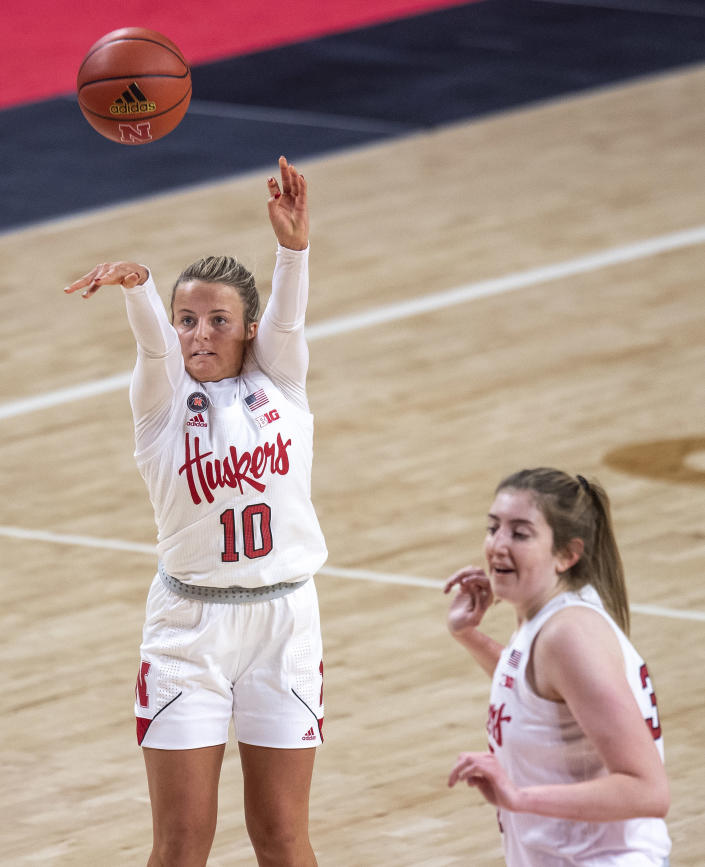 Nebraska's Whitney Brown (10) shoots for her second three-point basket against Northwestern in the first half as teammate Kate Cain (31) looks on during an NCAA college basketball game Thursday, Dec. 31, 2020, in Lincoln, Neb. (Francis Gardler/Lincoln Journal Star via AP)