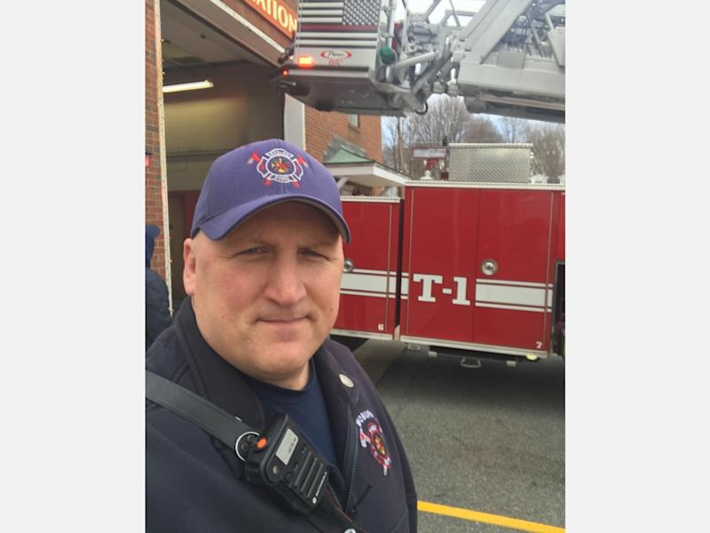 Wilmington's Derek Koster works overtime as an E.M.T., in addition to his work as a fire lieutenant.