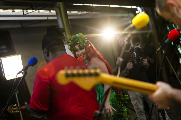 """Musicians perform in the """"Desliga da Justica"""" street band in Rio de Janeiro, Brazil, Sunday, Feb. 14, 2021. Their performance was broadcast live on social media for those who were unable to participate in the carnival due to COVID restrictions after the city's government officially suspended Carnival and banned street parades or clandestine parties. (AP Photo/Bruna Prado)"""