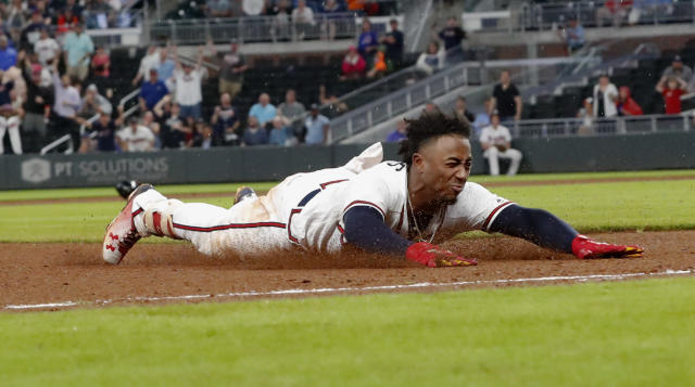 Atlanta Braves' Ozzie Albies slides into third base with a triple during the eighth inning of the team's baseball game against the Chicago Cubs on Wednesday, May 16, 2018, in Atlanta. The Braves won 4-1. (AP Photo/John Bazemore)