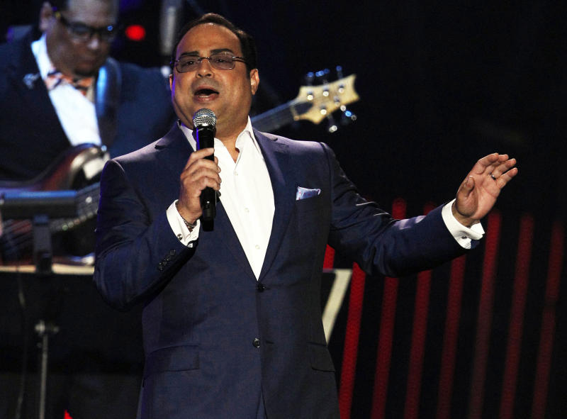 "FILE - This April 26, 2012 file photo shows Gilberto Santa Rosa performing during the Latin Billboard Awards in Coral Gables, Fla. Santa Rosa will make his Broadway debut as a guest vocalist in musical ""Forever Tango,"" which returns to the theater Mecca in July with some covers of the Puerto Rican singer's hits. (AP Photo/Lynne Sladky, file)"