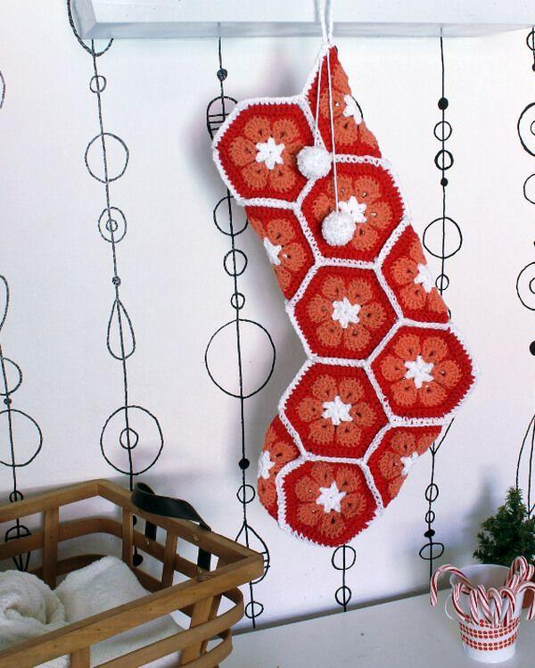 """<p>Cheery and contemporary, this stocking featuring flowers inside hexagonal shapes will brighten up any space.</p><p><strong>Get the tutorial at <a href=""""https://persialou.com/african-flower-crochet-stocking-free/"""" rel=""""nofollow noopener"""" target=""""_blank"""" data-ylk=""""slk:Persia Lou"""" class=""""link rapid-noclick-resp"""">Persia Lou</a>.</strong></p><p><a class=""""link rapid-noclick-resp"""" href=""""https://www.amazon.com/Clover-1008-Touch-5-0-mm-Crochet/dp/B000QHF90I?tag=syn-yahoo-20&ascsubtag=%5Bartid%7C10050.g.28872655%5Bsrc%7Cyahoo-us"""" rel=""""nofollow noopener"""" target=""""_blank"""" data-ylk=""""slk:SHOP SIZE H CROCHET HOOK"""">SHOP SIZE H CROCHET HOOK</a><br></p>"""