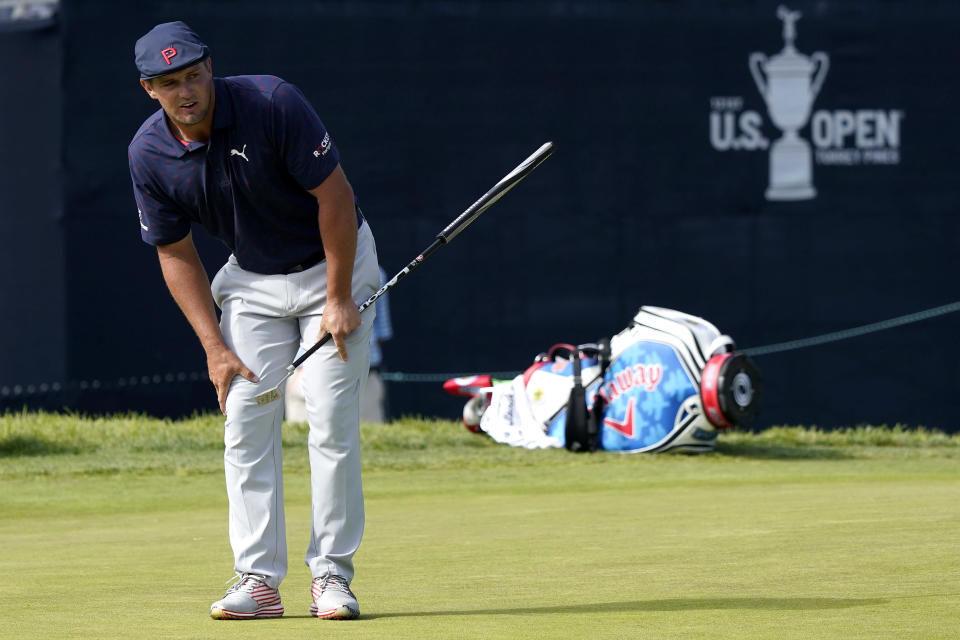 Bryson DeChambeau watches his putt miss the cup on the 18th green during the third round of the U.S. Open Golf Championship, Saturday, June 19, 2021, at Torrey Pines Golf Course in San Diego. (AP Photo/Marcio Jose Sanchez)