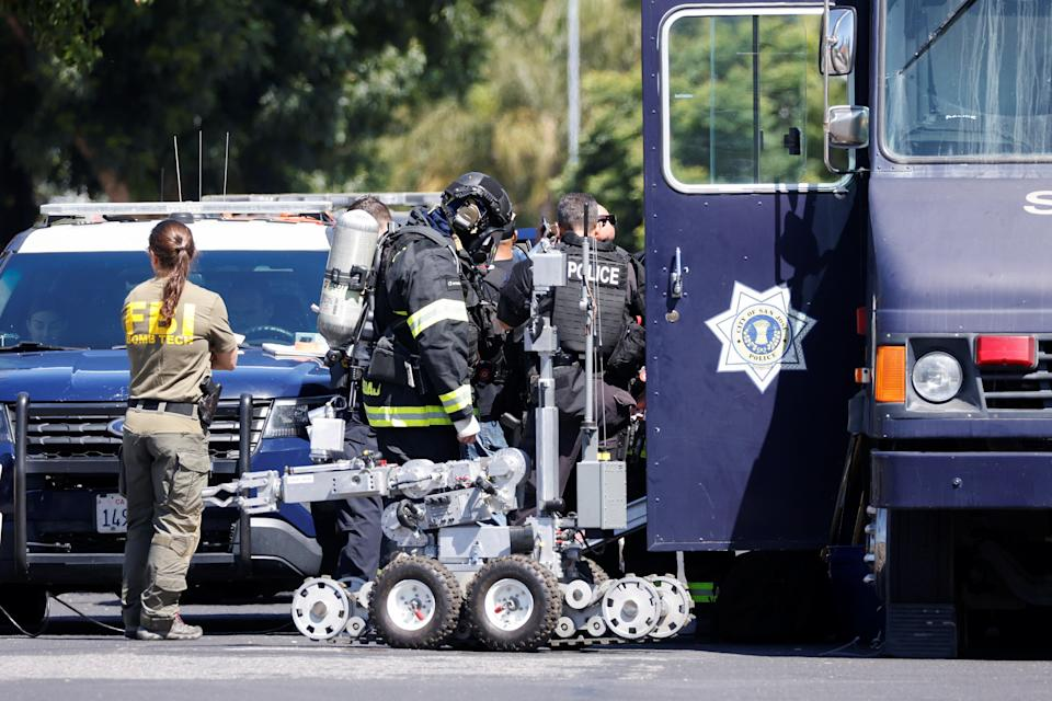 Bomb squad at scene of a mass shooting in San Jose (REUTERS)