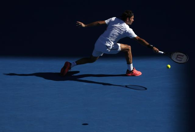 Tennis - Australian Open - Rod Laver Arena, Melbourne, Australia, January 22, 2018. Roger Federer of Switzerland hits a shot against Marton Fucsovics of Hungary. REUTERS/Edgar Su