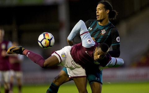 Virgil van Dijk made his long-awaited comeback this evening but looked anything like the most valuable defender in world football after his lack of match fitness was fully exposed by two Aston Villa teenagers. Having being forced to stay this season at Southampton despite acrimoniously handing in a transfer request, Van Dijk made what was his first appearance for the club since January in an Under-23 fixture at Walsall's Bescot Stadium. Van Dijk's inactivity was then fully evident in a 4-0 defeat that included three goals in which he was at least partially culpable. He was caught out after just 13 minutes for the first when he stepped out for an attempted interception but was side-stepped by Jordan Cox who then fired a low shot past Southampton goalkeeper Alex McCarthy. The 18-year-old Cox was then again too quick as he controlled the ball to Van Dijk's and then left smashed his finish past McCarthy. Van Dijk gets to grips with Aston Villa's Jonathan Kodjia Credit: ASTON VILLA FC Van Dijk was blameless for the third after Richard Bakary's underhit backpass was exploited by Corey Blackett-Taylor but the 26-year-old again looked rusty for the fourth when he stood off another 18-year-old – Callum O'Hare – and allowed him to finish past McCarthy. Regardless of the result and performance, Southampton will just be relieved to see Van Dijk back out on the pitch. He attracted interest from a series of leading clubs this summer, most notably Liverpool, and is valued well in excess of the £54 million record defensive fee that Manchester City paid for Kyle Walker. Van Dijk was not involved in Southampton's first team training and matches until the transfer window closed amid concerns about his commitment and focus. It meant that he has not played competitively since seriously injuring his ankle against Leicester City eight months ago but manager Mauricio Pellegrino invited him back into first-team training last week and now wants to again involve him in the senior team just as soon as he has recovered his match fitness.