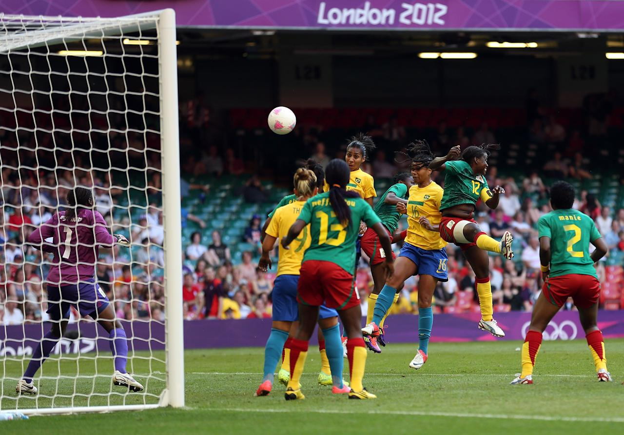 CARDIFF, WALES - JULY 25:  Renata Costa of Brazil scores a header during the Women's Football first round Group E Match of the London 2012 Olympic Games between Cameroon and Brazil at Millennium Stadium on July 25, 2012 in Cardiff, Wales.  (Photo by Julian Finney/Getty Images)