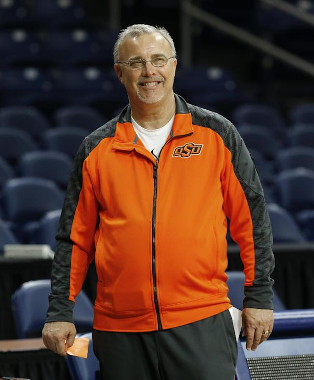 Oklahoma State head coach Jim Littell smiles during an NCAA women's college basketball tournament practice at the Purcell Pavilion in South Bend, Ind., Friday, March 28, 2014. Oklahoma State plays Notre Dame on Saturday. (AP Photo/Paul Sancya)