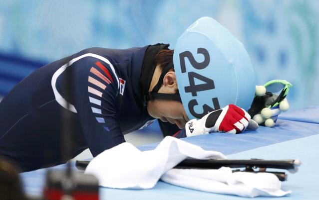 Sin Da-woon of Korea reacts after he crashed out in the men's 1,500 metres short track speed skating semi-final event at the Iceberg Skating Palace during the 2014 Sochi Winter Olympics
