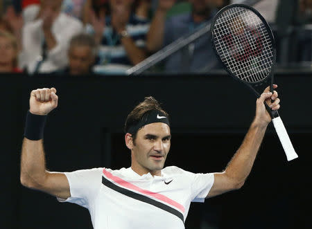 Roger Federer of Switzerland celebrates winning against Richard Gasquet of France. REUTERS/Thomas Peter