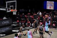Miami Heat's Bam Adebayo (13) shoots over Brooklyn Nets' Reggie Perry (0) during the second half of an NBA basketball game Saturday, Jan. 23, 2021, in New York. (AP Photo/Frank Franklin II)