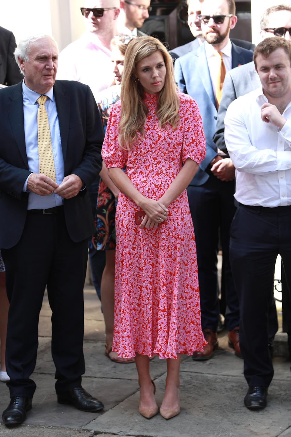 Carrie opted for a bright pink and red floral midi dress from British label Ghost for her debut appearance at No.10 earlier this summer [Photo: Getty Images]
