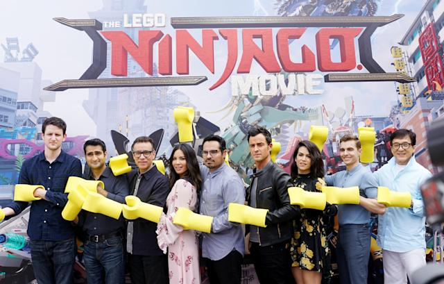 Aniston wasn't expected here. Theroux (in black leather jacket) promoted the movie with Zach Woods, Kumail Nanjiani, Fred Armisen, Olivia Munn, Michael Peña, Abbi Jacobson, Dave Franco, and Jackie Chan at Legoland in Carlsbad, Calif., on Sept. 14, 2017. (Photo: Getty Images)