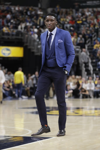 Indiana Pacers' Victor Oladipo walks onto the court during the second half of an NBA basketball game against the Detroit Pistons, Wednesday, Oct. 23, 2019, in Indianapolis. Detroit won 119-110. (AP Photo/Darron Cummings)