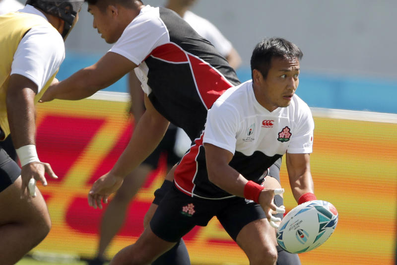 Japan's Yutaka Nagare passes the ball during a training session in Tokyo, Japan, Thursday, Sept. 19, 2019. The Rugby World Cup starts Friday, Sept. 20, with Japan playing Russia, and ends with the final on Nov. 2. (AP Photo/Christophe Ena)