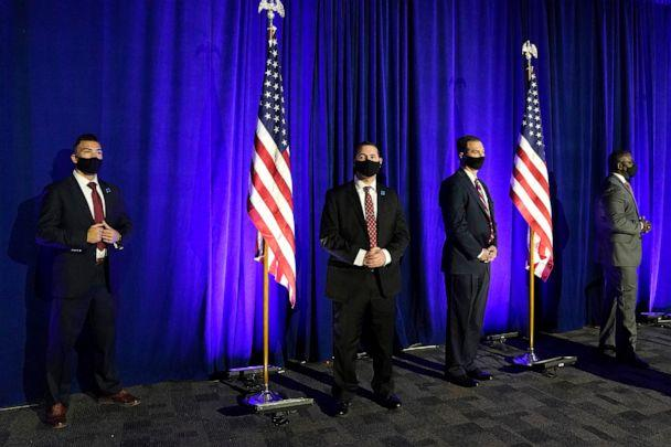 PHOTO: Secret Service agents stand by as Democratic presidential nominee Joe Biden addresses the nation at the Chase Center in Wilmington, Del., Nov. 6, 2020. (Drew Angerer/Getty Images, FILE)