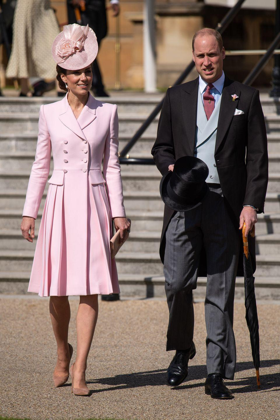 """<p><a href=""""https://www.townandcountrymag.com/style/fashion-trends/a27542768/kate-middleton-pink-alexander-mcqueen-buckingham-palace-garden-party-2019/"""" rel=""""nofollow noopener"""" target=""""_blank"""" data-ylk=""""slk:At one of the Queen's Garden Parties, on the grounds of Buckingham Palace, Kate paired a coatdress"""" class=""""link rapid-noclick-resp"""">At one of the Queen's Garden Parties, on the grounds of Buckingham Palace, Kate paired a coatdress</a>—from one of her all-time favorite designers, Alexander McQueen—with a headpiece by Juliette Botterill.</p>"""