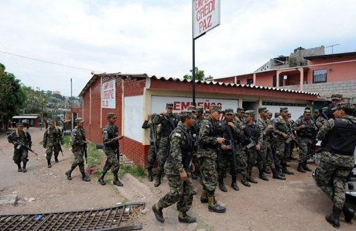 Soldiers are deployed across the most dangerous neighbourhoods of Tegucigalpa on May 3