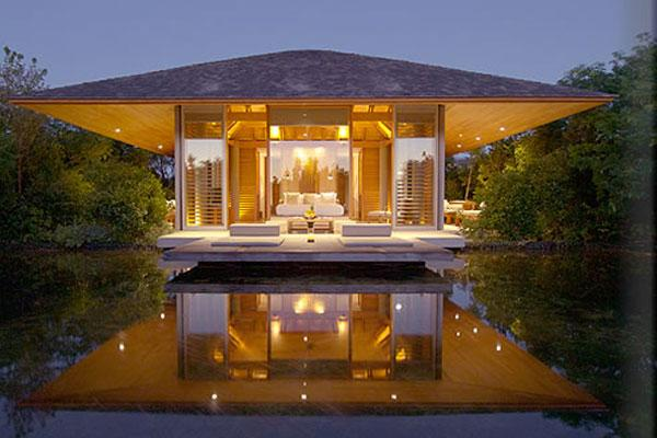"<div class=""caption-credit""> Photo by: Amanyara Resorts</div><div class=""caption-title"">2. Pavilion Suite At Amanyara In Turks & Caicos</div><p>   Normally, we aren't ones for an Asian-influenced feel anywhere west of the Pacific. But Amanyara's peaceful - and yes, zen - pavilion suites have the distinct power of making you feel as though you've left everything behind months ago as opposed to mere hours. And the hardest decision you've got to make is where your room is at its most tranquil. Of course, the view of nothing but tropical landscape can be considered the best from the king-size bed that's set in the middle of the glass-and-timber mini-villa suite. For more info, visit <a rel=""nofollow"" href=""http://www.bridalguide.com/planning/wedding-reception/fall-wedding-ideas"" target="""">amanresorts.com</a>. </p> <p>   <b>Related: <a rel=""nofollow"" href=""http://www.bridalguide.com/honeymoons/caribbean/turks-and-caicos-seven-stars-resort"" target="""">Honeymoon in Turks and Caicos</a></b> </p>"