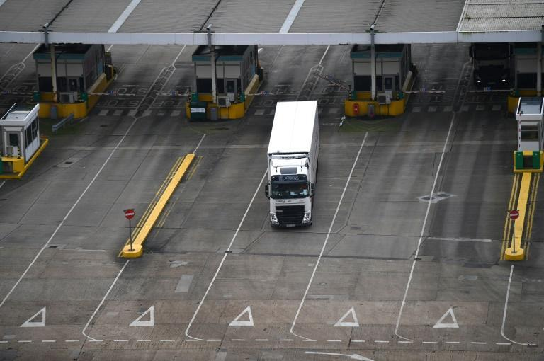 A small but steady stream of lorries arrived through Friday morning at the Port of Dover in southeast England