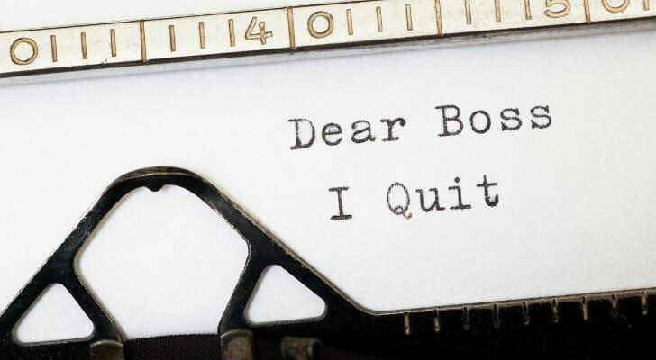 """Image shows a note written on a typewriter; it reads, """"Dear Boss, I Quit."""" A record 3.8 million workers quit their jobs in April 2021. SmartAsset breaks down industry quit rates."""