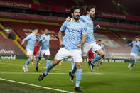 Manchester City's Ilkay Gundogan celebrates with Bernardo Silva, center right, after scoring the opening goal during the English Premier League soccer match between Liverpool and Manchester City at Anfield Stadium, Liverpool, England, Sunday, Feb. 7, 2021. (AP photo/Jon Super, Pool)
