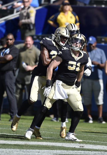 New Orleans Saints linebacker Colton Jumper celebrates with teammates after intercepting a pass during the fourth quarter of a preseason NFL football game against the Los Angeles Chargers Sunday, Aug. 18, 2019, in Carson, Calif. (AP Photo/Kelvin Kuo )