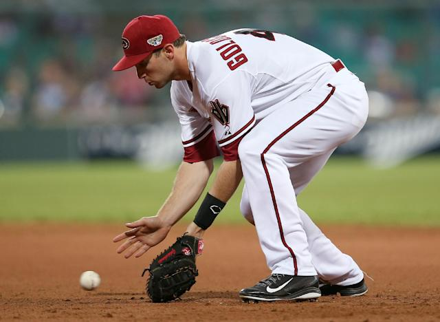 The Diamondbacks' first baseman Paul Goldschmidt picks up a grounder from the Dodgers' Andre Ethier in the top of the 9th inning in the Major League Baseball opening game between the Los Angeles Dodgers and Arizona Diamondbacks at the Sydney Cricket ground in Sydney, Saturday, March 22, 2014. The Dodgers won the game 3-1. (AP Photo/Rick Rycroft)