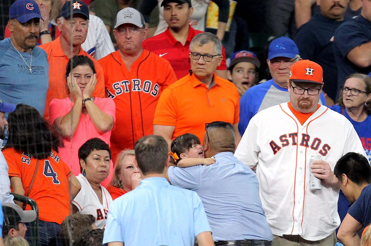May 29, 2019; Houston, TX, USA; A young fan is taken up to the concourse to receive medical attention after being hit by a foul ball by Chicago Cubs center fielder Albert Almora Jr. (5) during the fourth inning against the Houston Astros at Minute Maid Park. Mandatory Credit: Erik Williams-USA TODAY Sports