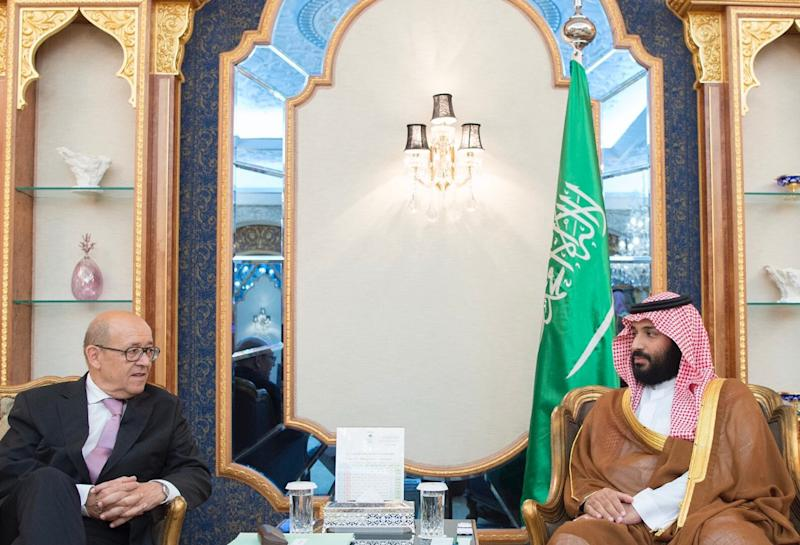 In this photo provided by the Saudi Press Agency, Saudi Crown Prince Mohammed bin Salman, right, receives French Foreign Minister Jean-Yves Le Drian in Jiddah, Saudi Arabia on Saturday, July 15, 2017. Le Drian is the latest diplomat to visit the Gulf to try and help find a solution to the crisis between Qatar and Saudi Arabia, the United Arab Emirates, Bahrain and Egypt, which cut ties with the small Gulf nation in early June. (Saudi Press Agency via AP)