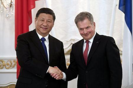 China's President Xi Jinping and Finland's President Sauli Niinisto shake hands during the signing ceremony at the Presidential Palace in Helsinki