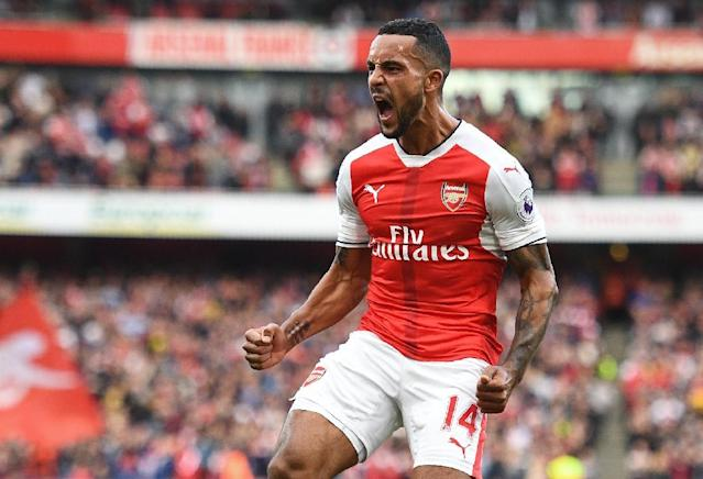Arsenal's English midfielder Theo Walcott celebrates after scoring during their match against Swansea City in London on October 15, 2016 (AFP Photo/Justin Tallis)