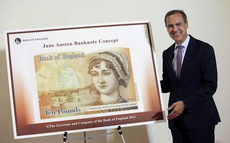 Bank of England governor Mark Carney with the new £10 note which was released today - AFP