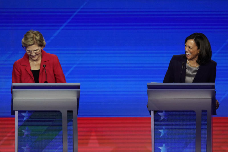 Democratic presidential candidates Sen. Elizabeth Warren, D-Mass. and Sen. Kamala Harris, D-Calif., laugh Thursday, Sept. 12, 2019, during a Democratic presidential primary debate hosted by ABC at Texas Southern University in Houston. (AP Photo/David J. Phillip)