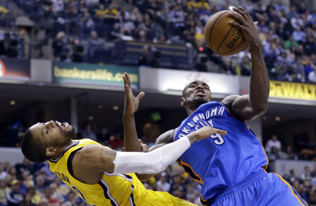 Oklahoma City Thunder forward Serge Ibaka, right, fouls Indiana Pacers guard C.J. Watson as he grabs a rebound in the second half of an NBA basketball game in Indianapolis, Sunday, April 13, 2014. Ibaka was also charged with a technical after complaining about the foul call. The Pacers defeated the Thunder 102-97. (AP Photo/Michael Conroy)