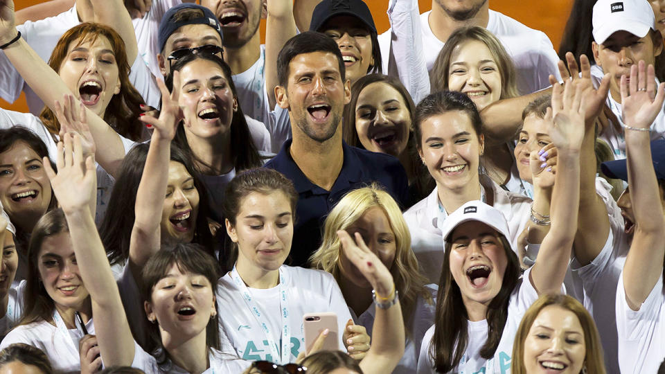 Novak Djokovic, pictured here with volunteers at the Adria Tour tennis event.