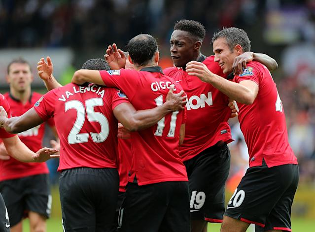 Manchester United's Danny Welbeck (centre right) celebrates scoring his sides second goal of the game with team-mates