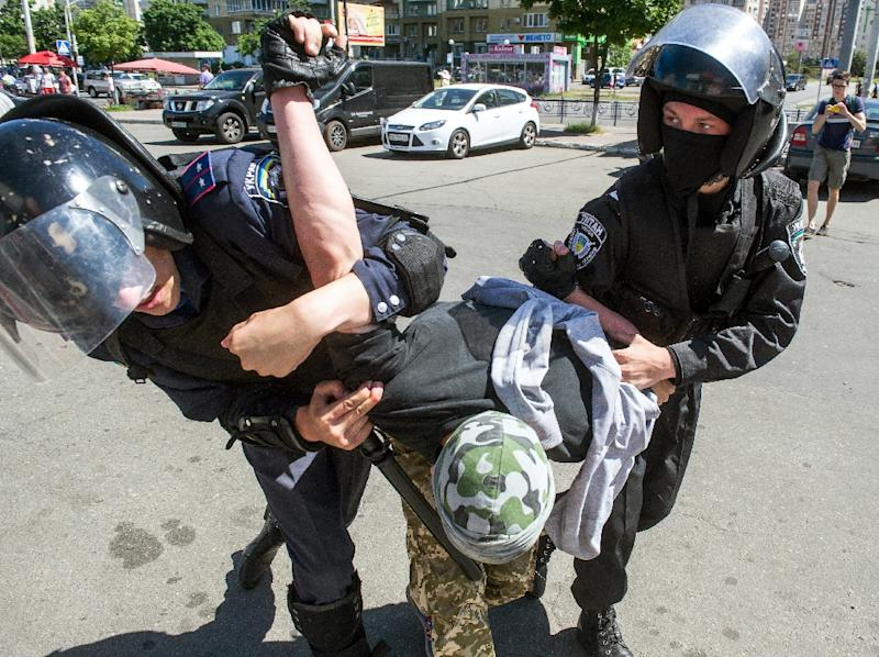 "Riot policemen arrest a right-wing activist during a protest against the first ""March of Equality"" parade in Kiev, since fighting with pro-Moscow rebels broke out in the east of the country last year, on June 6, 2015 (AFP Photo/Volodymyr Shuvayev)"