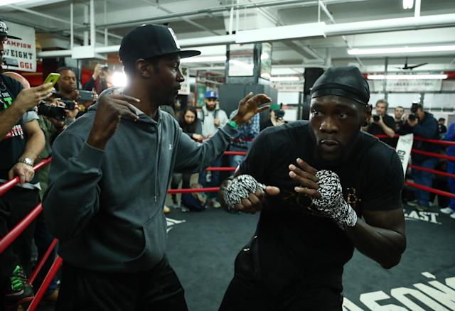 Trainer Mark Breland (L) puts WBC heavyweight champion Deontay Wilder through his paces Wednesday in a workout at Gleason's Gym prior to his bout on Saturday with Bermane Stiverne in Brooklyn. (Getty Images)