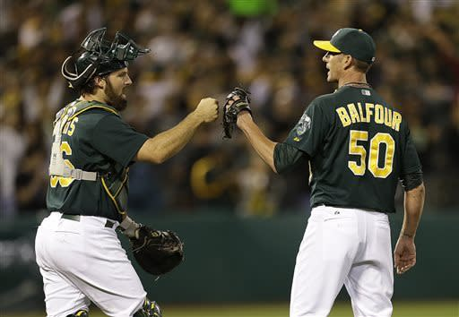 Oakland Athletics' Grant Balfour, right, celebrates with catcher Derek Norris after the final out is made against the Kansas City Royals at the end of a baseball game Saturday, May 18, 2013, in Oakland, Calif. (AP Photo/Ben Margot)