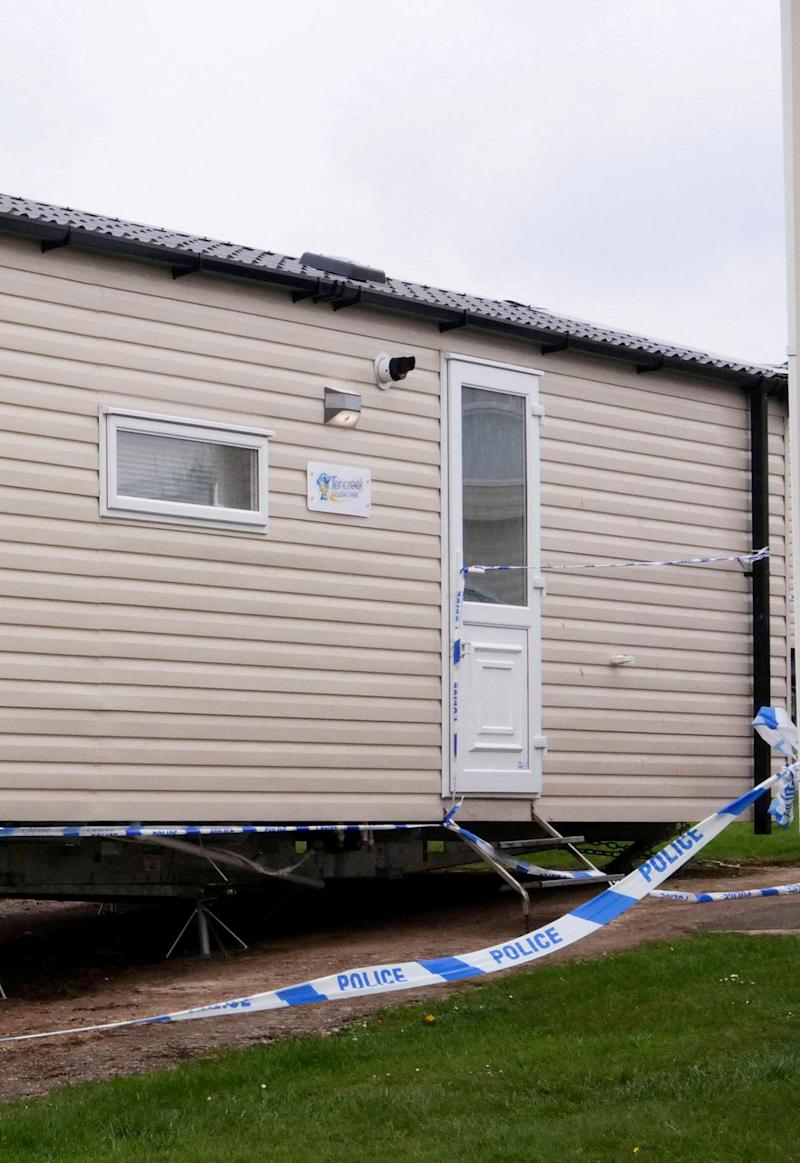 Police taped off a large area around static caravans at the Tencreek Holiday Park. (SWNS)
