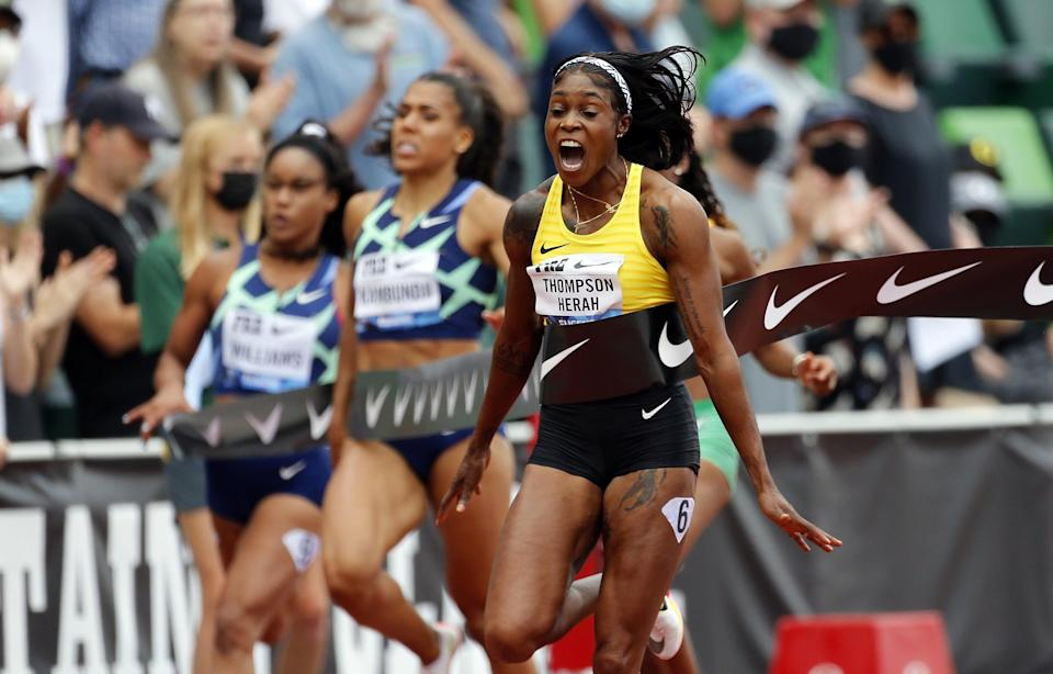 """<p>Finishing first in the women's 100m, Team Jamaica's Elaine Thompson-Herah ran the second fastest time (10.54) in the race's history with the fastest time set by track legend <a href=""""http://www.popsugar.com/fashion/photo-gallery/48211939/image/48211947/Florence-Griffith-Joyner"""" class=""""link rapid-noclick-resp"""" rel=""""nofollow noopener"""" target=""""_blank"""" data-ylk=""""slk:Florence Griffith Joyner"""">Florence Griffith Joyner</a> (10.49).</p>"""