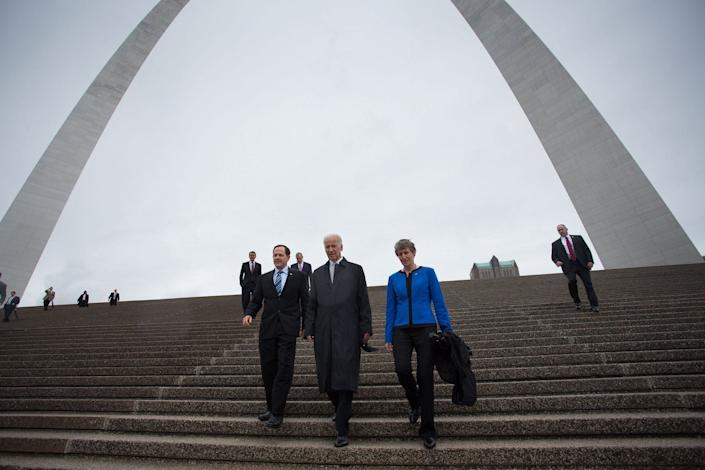 Biden, St. Louis Mayor Francis Slay, left, and Secretary of the Interior Sally Jewell walk down the stairs underneath the Gateway Arch, at the Jefferson National Expansion Memorial in St. Louis, Missouri, on May 13, 2014.
