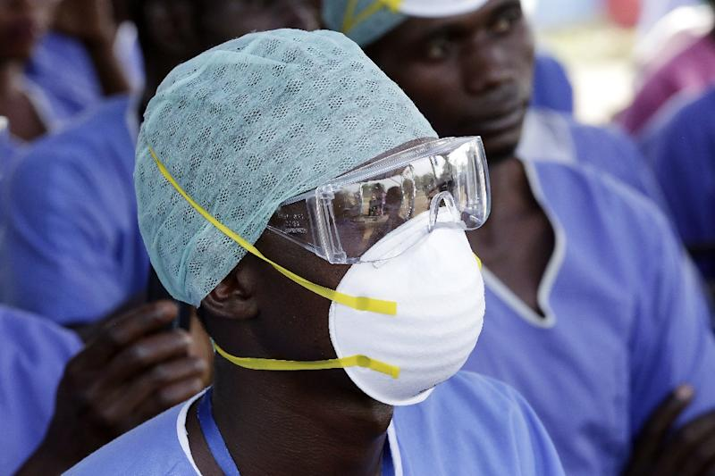 """The WHO will announce the end of a two-year Ebola outbreak on January 15, 2016, to """"mark 42 days since the last Ebola cases in Liberia were tested negative"""" (AFP Photo/Evan Schneider)"""