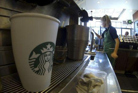 FILE PHOTO: A barista makes drinks inside a newly designed Starbucks coffee shop in Fountain Valley, California August 22, 2013. REUTERS/Mike Blake