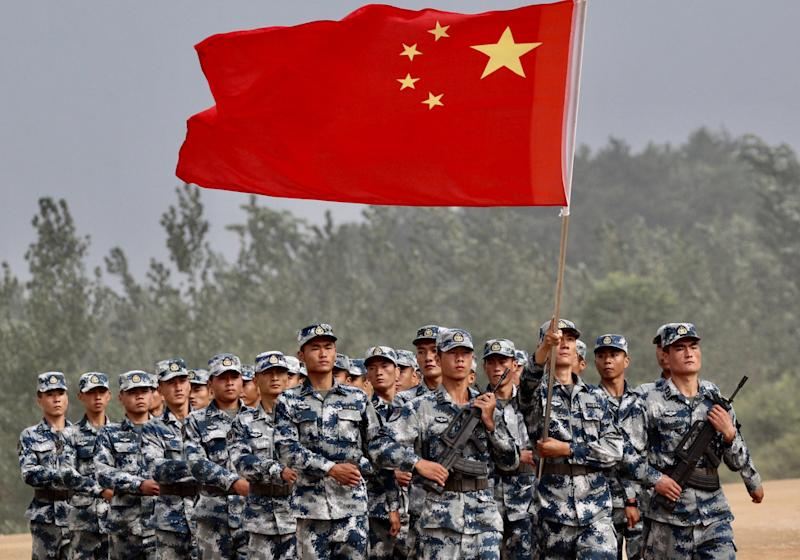 Chinese army servicemen with the national flag attend the opening ceremony of the airborne platoon competition, part of the International Army Games 2017, at Guangshui, Hubei province, China, July 30, 2017. China Daily via REUTERS